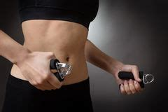 Woman Hand Holding And Using A Hand Grip Stock Photo