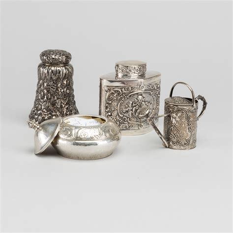 A set of four different silver objects, different makers