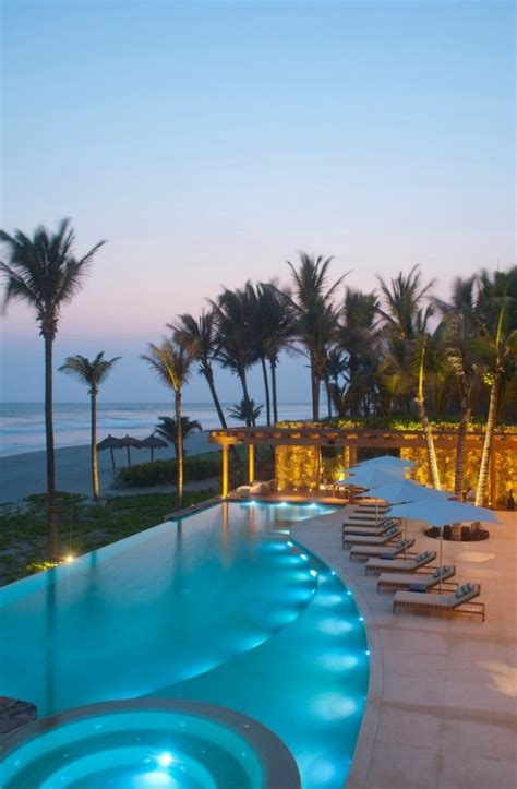 16 Exotic Tropical Swimming Pool Designs For The Ultimate