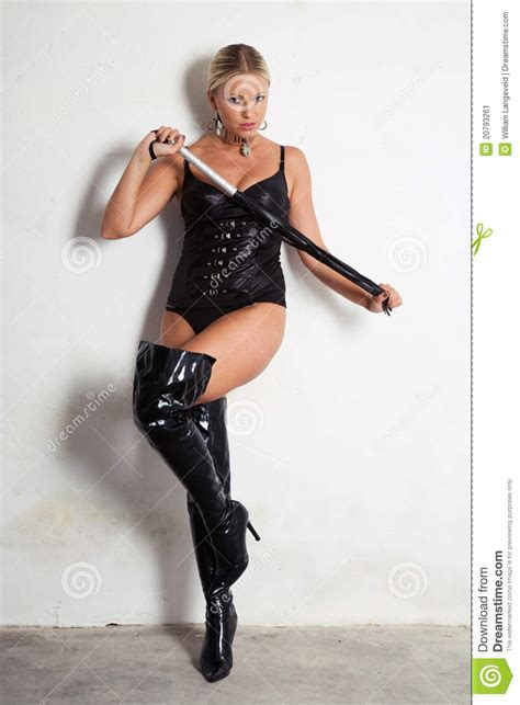 Beautiful Woman On High Heels Holding A Whip Stock Image